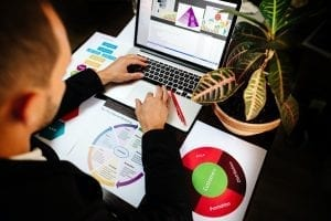 marketing product manager holding marketing promotion plan