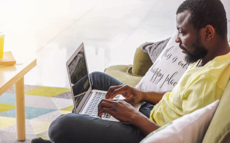 African-Americanbloggerwithlaptopathome